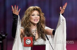 LaToya Jackson  accepts the 'St. George's Great Medal of Gratitude' honouring her late brother Michael Jackson during the opening...