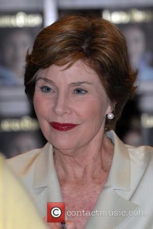 Laura Bush  signs copies of her memoir 'Spoken From The Heart' at Books and Books  Coral Gables, Florida...
