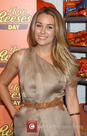 Lauren Conrad  signing a petition to declare 'I Love Reese's Day' at the Hershey Store in Time Square New...
