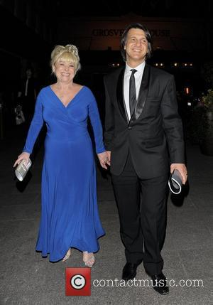 Barbara Windsor and Scott Mitchell The 2010 Laurence Olivier Awards held at the Grosvenor House Hotel - Arrivals. London, England...