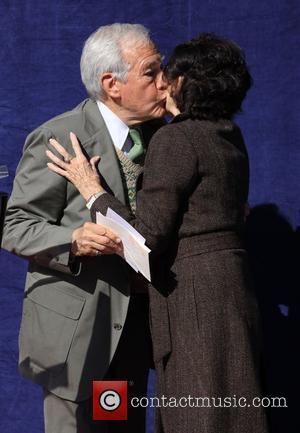 Leslie Caron and Jack Larson