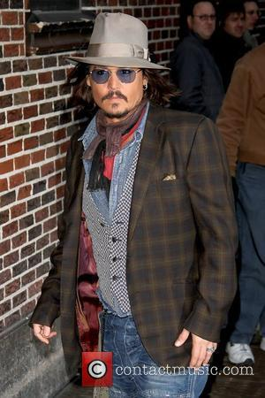 Depp Moved By Two Golden Globe Nods