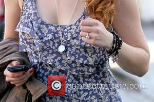 Leven Rambin's engagement ring actress Leven Rambin picks up eco-friendly reused jeans and Kathryn Bobby jewelry at a private residence...
