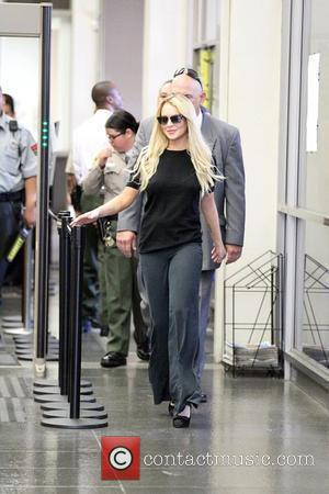 Lohan Reports For Jail