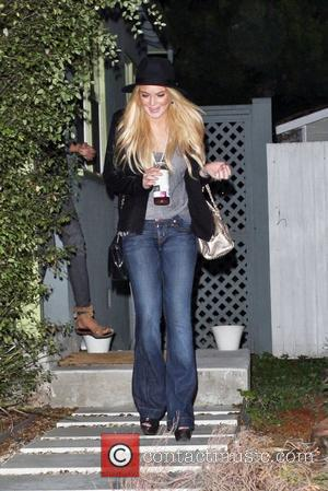 Lohan Faces Nightly Checks With Probation Officer