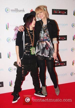 Lady Sovereign and Ekaterina Ivanova arrive for the 'Brit Celebration in aid of Haiti' held at The River Room London,...