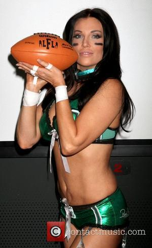 Model/actress Angelica Bridges of the Lingerie Football League's newly-formed Las Vegas team unveils the 2011 Lingerie Bowl official game uniforms...