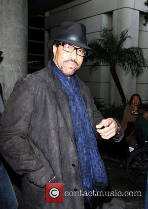 Lionel Richie arriving at LAX on a flight from London while wearing a black hat Los Angeles, California - 21.01.10