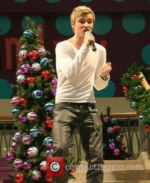 Lloyd Daniels performing live during the 'X Factor' Charity sing-along at the Trafford Centre Manchester, England - 08.12.09