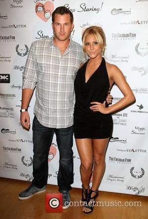 Doug Reinhardt and Cassie Scerbo