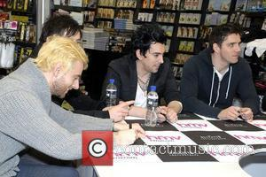 Lee Gaze, Mike Lewis, Ian Watkins, Stuart Richardson Lostprophets sign copies of their new album 'The Betrayed' at HMV Cardiff,...