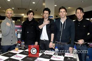Lee Gaze, Mike Lewis, Ian Watkins, Stuart Richardson and Jamie Oliver Lostprophets sign copies of their new album 'The Betrayed'...