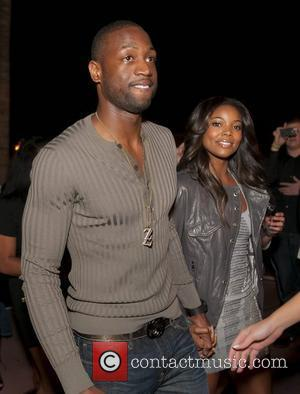 Dwyane Wade, Gabrielle Union and Lebron James
