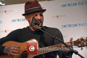 Benji Madden  Benji and Joel Madden of Good Charlotte perform at the Cherry Hill Macy's to promote their clothing...