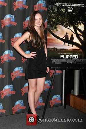 Madeline Carroll promotes her new movie 'Flipped' with a memorabilia donation at Planet Hollywood in Times Square. New York City,...