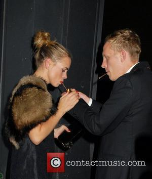 Billie Piper and her husband Laurence fox smoke a cigarette outside Shoreditch House in London's trendy East End London, England...