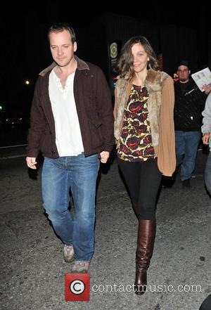 Maggie Gyllenhaal and her fiance Peter Sarsgaard leaving the charity Radiohead concert in benefit of the Haity earthquake Los Angeles,...