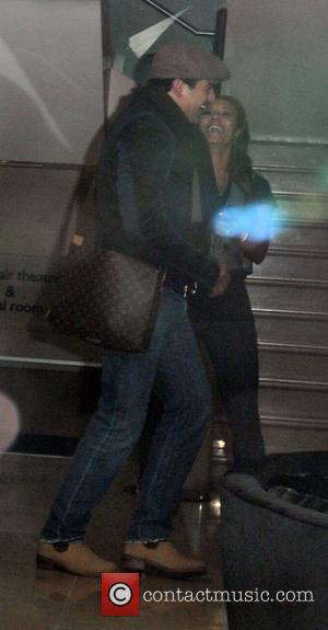 Tamer Hassan and Melanie Brown leaving the May Fair hotel London, England - 24.11.10