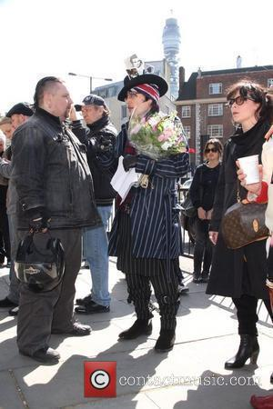 Adam Ant aka Stuart Goddard chats to mourners outside the Holy Trinity Church in Marylebone before a funeral service for...