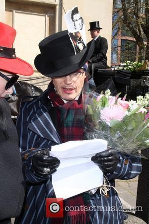 Adam Ant aka Stuart Goddard arrives at the Holy Trinity Church in Marylebone to attend a funeral service for the...