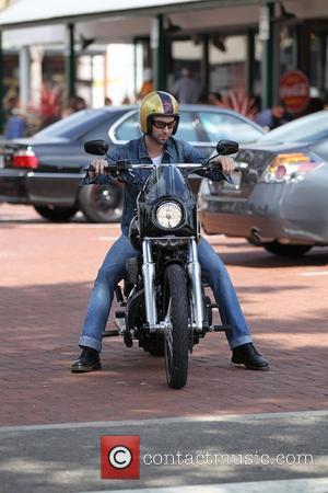 Adam Levine out and about on his motorcycle at Malibu Country Mart in Malibu on July 4th - Independence Day...