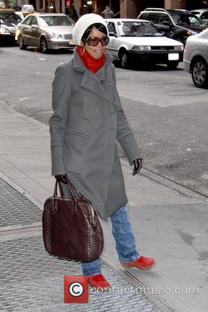 Malinda Williams 'Soul Food' star out and about in Manhattan while wearing red winter boots New York City, USA -...