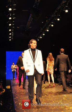 Carlos Tevez Manchester City players take to the catwalk and model clothes from Selfridges department store at the fashion kicks...