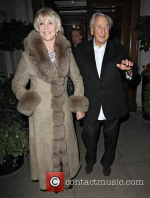 Michael Winner and Geraldine Lynton-Edwards;,  at the launch of CNN's 'Piers Morgan Tonight' at the Mandarin Oriental hotel. -...
