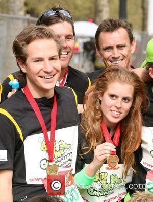 Dave Clark and Princess Beatrice The finish line of the 2010 Virgin London Marathon at the Mall London, England -...