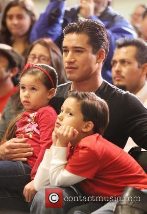 Mario Lopez and his family watch members of BGCV perform a pantomime on stage for Millions of Milkshakes  Culver...