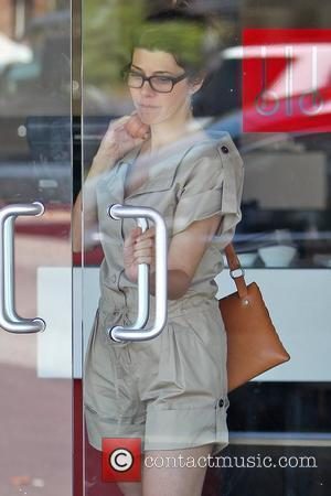 Marisa Tomei, wearing no makeup and seen leaving a West Hollywood restaurant after meeting up a friend for lunch