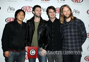 Gene Hong, Sam Farrar, Adam Levine, James Valentine Adam Levine and James Valentine of Maroon 5 perform at Haze Nightclub...