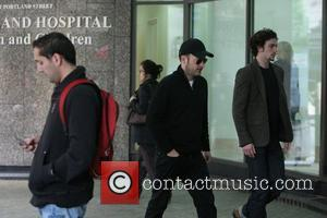Matthew Vaughn and Aaron Johnson arriving at the hospital where Vaughn's wife recently gave birth to a baby girl London,...