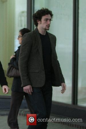 Aaron Johnson heading to the hospital where Claudia Schiffer recently gave birth to a baby girl London, England - 17.05.10