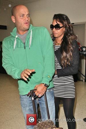Mel B, aka Mel B and husband Stephen Belafonte arrive at LAX airport on a Virgin Atlantic flight from London Heathrow.