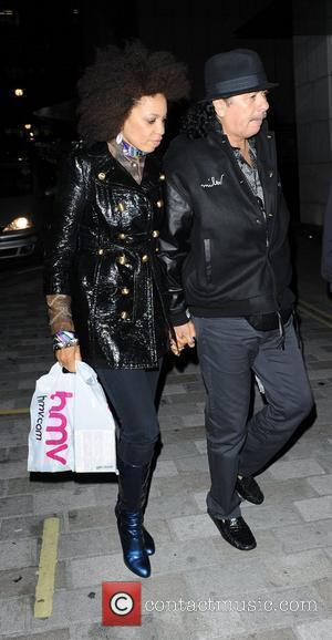 Carlos Santana and his fiance Cindy Blackman at Metropolitan Hotel London, England - 30.09.10