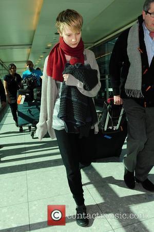 Mia Wasikowska arriving at a London airport London, England - 08.03.10