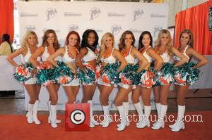 The Miami Dolphins Cheerleaders appear on the Orange Carpet prior to the Miami Dolphins vs Cleveland Browns NFL game. Miami...