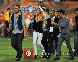 Anna Kournikova on the pitch at the Sun Life Stadium before the Miami Dolphins vs. New York Jets NFL game...