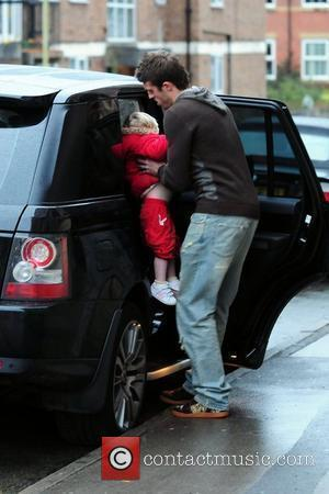 Manchester United, England Footballer Michael Carrick puts his daughter Louise in the car after eating at 'Fosters Fish and Chip Shop' in Alderley Edge.
