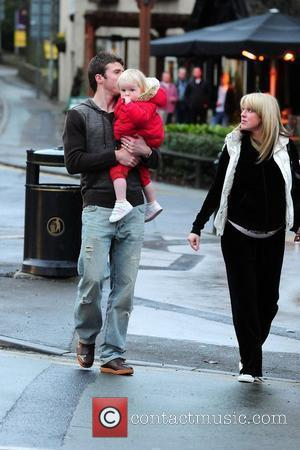 Manchester United and England Footballer Michael Carrick with his wife Lisa and their daughter Louise after eating at 'Fosters Fish...