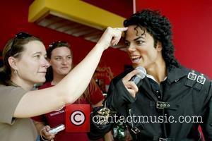 Fan touching Michael Jackson's wax figure Madame Tussauds in Washington, D.C. installs a Michael Jackson tribute exhibit to mark the...