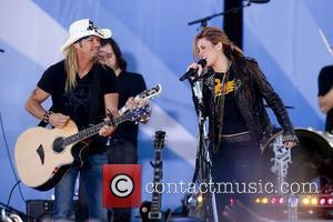 Bret Michaels and Miley Cyrus  perform on ABC's 'Good Morning America' at Rumsey Playfield, Central Park New York City,...