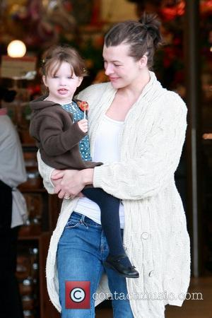 Milla Jovovich and her daughter Ever Gabo Anderson shop for groceries at Bristol Farms Beverly Hills, USA - 21.02.10