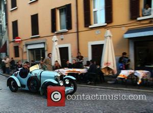 Italian entry for the 2010 Mille Miglia with a 1927 Amilcar C6SS racing through the streets of Brescia Brescia, Italy...