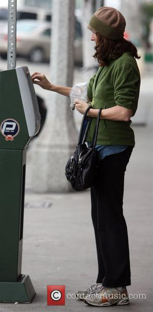 Molly Shannon seen putting money into a parking meter before getting coffee in West Hollywood. Los Angeles, California - 02.02.10