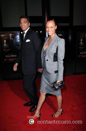 Tyra Banks and John Utendahl  New York premiere of 'Wall Street: Money Never Sleeps' at the Ziegfeld Theatre -...