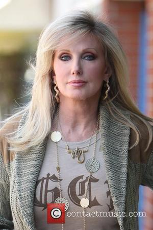 Morgan Fairchild walking in Beverly Hills wearing a long gold necklace Los Angeles, California - 23.04.10