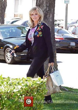 Morgan Fairchild walking in Beverly Hills wearing a black sweater Los Angeles, California - 27.08.10