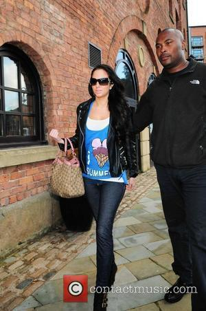 Tulisa Contostavlos of N Dubz arrives at Key 103 radio station wearing a vest from Pharrell's clothing line 'Billionaire Boy's...